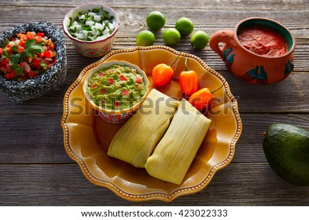 Mexican Tamale tamales of corn leaves with chili and sauces - stock photo