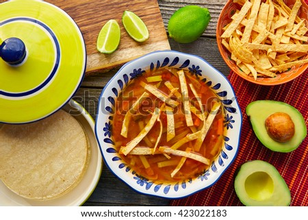 Mexican tortilla soup and aguacate colorful mexico food - stock photo