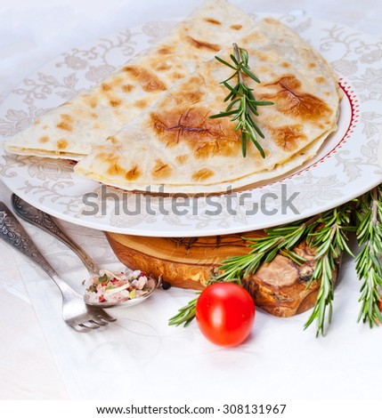 Mexican tortilla with meat stuffing, corn and vegetable salsa - stock photo