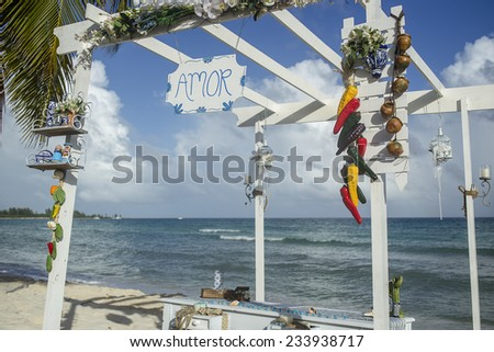mexican wedding gazebo on a beach in riviera maya - stock photo