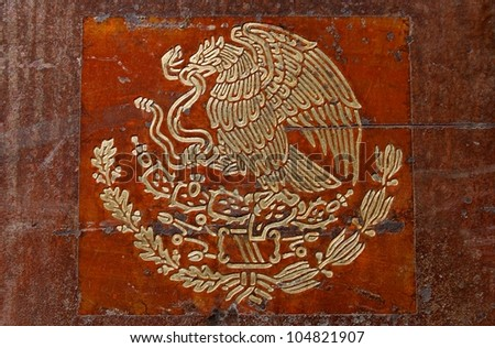 Mexicans flag coat of arms closeup - stock photo