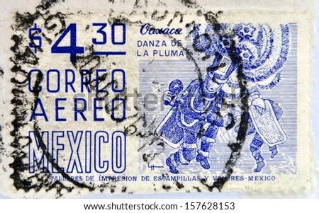 MEXICO - CIRCA 1950: a stamp printed in Mexico shows feather dance, Oaxaca, circa 1950  - stock photo