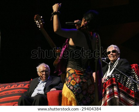 MEXICO CITY - APRIL 21 : Carlos Monsivais (L) and Chavela Vargas (R) look at the singer Lila Downs (C) during the Chavela Vargas 90th Anniversary homage on April 21, 2009 in Mexico City, Mexico. - stock photo