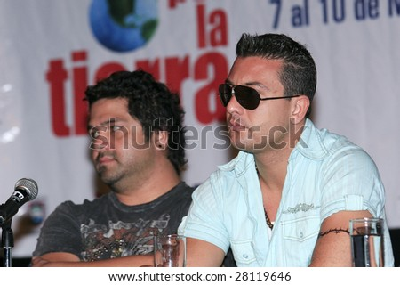 MEXICO CITY - APRIL 6: (L-R) Elephant Mexican pop rock band members Iguana and Javier attend Festival Music for the Earth Music Fest press conference at El Lunario April 6, 2009 in Mexico City. - stock photo