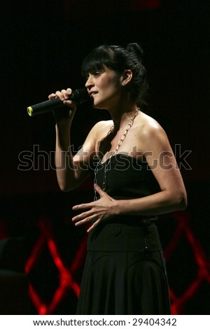 MEXICO CITY - APRIL 21 2009: Singer Julieta Venegas performs during The Chavela Vargas 90th Aniversary homage at the Teatro de La Ciudad de Mexico on April 21, 2009 in Mexico City, Mexico. - stock photo