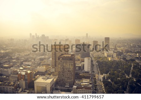 Mexico city industrial part covered in haze on sunset seen from the Latin American Tower, Mexico - stock photo