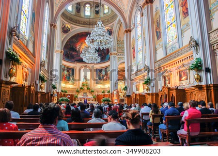 MEXICO CITY - MARCH 14, 2011: Interior of an unidentified church with people during the monday sermon - stock photo