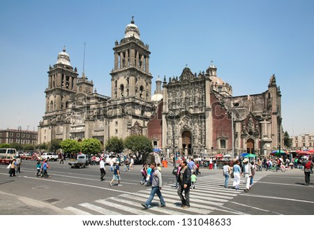 MEXICO CITY -MARCH, 3, 2012: People crossing the street on Plaza de la Constitucion in front of Cathedral Metropolitana  and Metropolitan Tabernacle  on march 3, 2012 in Mexico City, Mexico. - stock photo