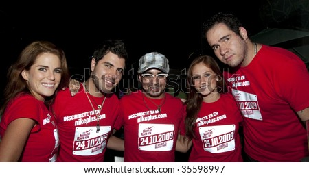 "MEXICO CITY, MEXICO-August 11: Karla Souza (1st L) & Mario Sandoval (3th L to r) attends the ""Nike+ Human Race 10k"" Press-conference; August 11 2009 in Mexico,City.,Mexico. - stock photo"