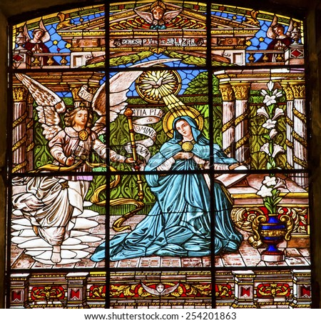 MEXICO CITY, MEXICO-DECEMBER 25, 2015 Annunciation Angel Gabriel Tells Mary She Will Give Birth to Jesus Stained Glass Old Basilica Guadalupe Mexico City Mexico - stock photo
