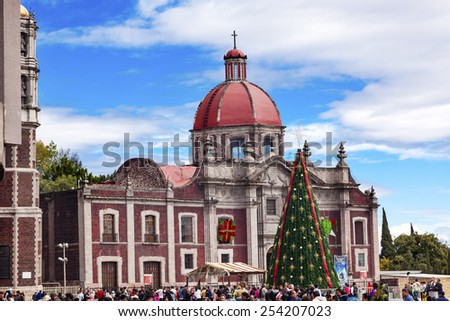 MEXICO CITY, MEXICO-DECEMBER 25, 2014 Old Basilica Christmas Tree Shrine of the Guadalupe Mexico City Mexico. Place where the Virgin Mary appeared to the Mexican peasant Juan Diego. - stock photo