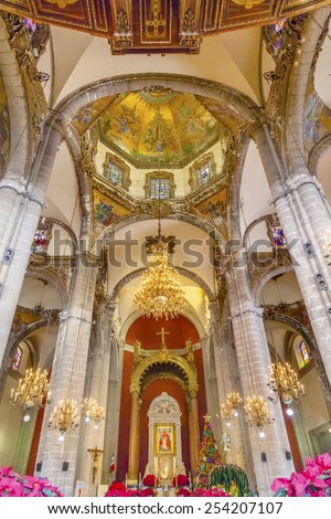 MEXICO CITY, MEXICO-DECEMBER 25, 2014 Old Basilica Shrine of Guadalupe Dome Chandelier Christmas Day Mosaics  Mexico City Mexico. Place where Virgin Mary appeared to the Mexican peasant Juan Diego.   - stock photo