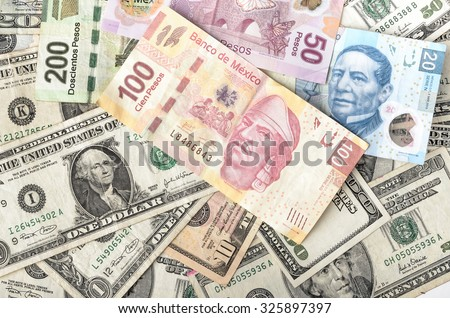 MEXICO CITY / MEXICO - SEPTEMBER 14 2015: Dollar and Mexican Peso exchange rate, assorted bills cash pile background - stock photo
