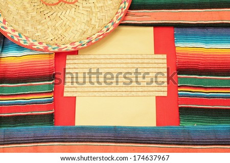 Mexico fiesta frame poncho serape sombrero background with copy space  - stock photo
