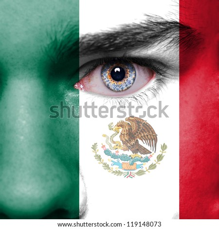 Mexico flag painted on face - stock photo