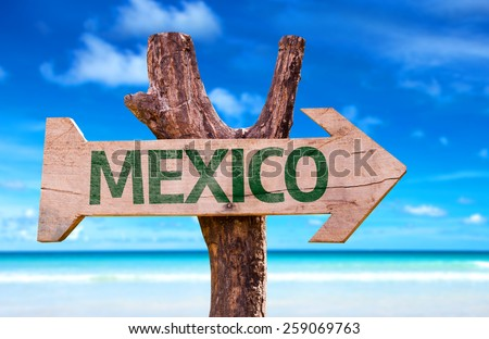Mexico wooden sign with a beach on background - stock photo
