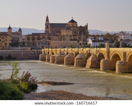 Mezquita-Catedral and Puente Romano - Mosque-Cathedral and the Roman Bridge in Cordoba, Andalusia, Spain - stock photo