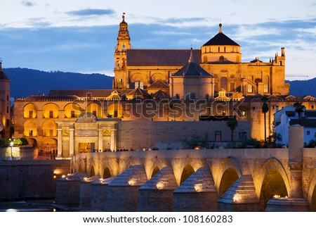Mezquita Cathedral (The Great Mosque) illuminated at dusk in Cordoba, Andalusia, Spain. - stock photo