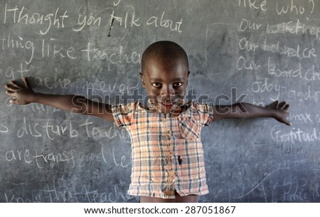 MFANGANO ISLAND - KENYA - DECEMBER 26, 2014: Unidentified orphan in an orphan boarding school on December 26, 2014 on Mfangano Island, Kenya. Many children lost their parents because they died of HIV. - stock photo