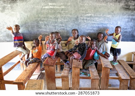 MFANGANO ISLAND - KENYA - DECEMBER 26, 2014: Unidentified orphans in an orphan boarding school on December 26, 2014 on Mfangano Island, Kenya. Many children lost their parents because they died of HIV - stock photo
