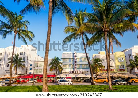 MIAMI - August 10 : Miami Beach, Florida hotels and restaurants on Ocean Drive on August 10, 2014. World famous destination for it's nightlife, beautiful weather and pristine beaches - stock photo
