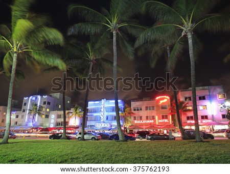 MIAMI BEACH - DECEMBER 28: Ocean Drive, the center of the Miami Art Deco District, which is home to about 800 preserved buildings and famous for nightlife.Shot on December 28, 2015 in Miami Beach, USA - stock photo