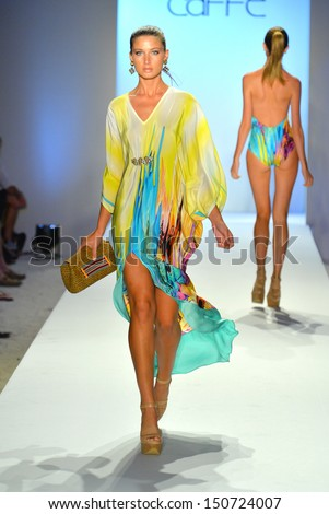 MIAMI BEACH, FL - JULY 21: A model walks the runway at the Caffe Swimwear show during Mercedes-Benz Fashion Week Swim 2014 at the Raleigh on July 21, 2013 in Miami Beach, Florida - stock photo