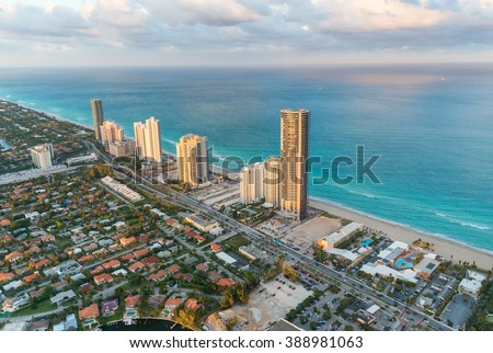 Miami Beach, Florida. Amazing sunset view from helicopter. - stock photo