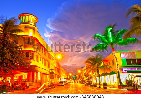 Miami Beach, Florida Moving traffic hotels and restaurants at sunset on Ocean Drive, world famous destination for it's nightlife, beautiful summer  weather and pristine beaches - stock photo