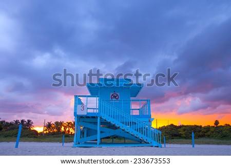 Miami Beach Florida,  typical Art Deco lifeguard house at sunset - stock photo