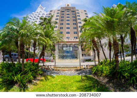 Miami Beach, Florida USA - August 1, 2014: The beautiful National Hotel in Miami Beach, a popular international travel destination, fish eye view with palm trees and art deco architecture. - stock photo