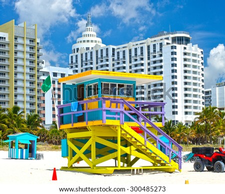 Miami Beach Florida, USA famous tropical travel location, typical Art Deco lifeguard house and hotels on a beautiful summer day  - stock photo