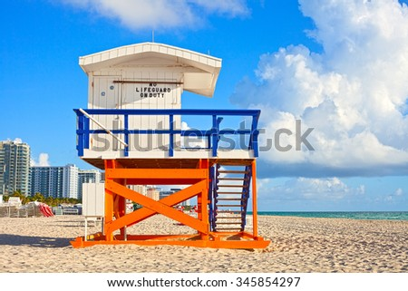 Miami Beach Florida, USA famous tropical travel location, typical Art Deco lifeguard house on a beautiful summer morning with ocean and blue sky  - stock photo