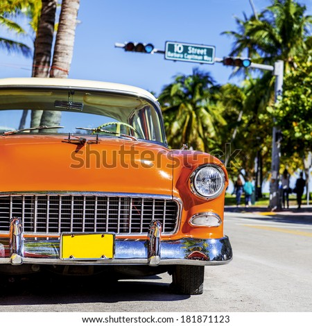 MIAMI BEACH - JANUARY 22. Vintage Car Parked along Ocean Drive in the Famous Art Deco District in South Beach. South Beach, FL, January 22, 2014.  - stock photo
