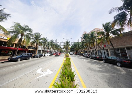 MIAMI BEACH - JULY 29: Street shot of Washington Avenue Miami Beach facing south with storefronts on both sides July 29, 2015 in Miami Beach FL USA - stock photo