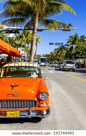 MIAMI BEACH - MARCH 20. Vintage Car Parked along Ocean Drive in the Famous Art Deco District in South Beach. South Beach, FL, JANUARY 22, 2014.  - stock photo