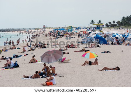 MIAMI BEACH, USA - MARCH 14, 2016: South Beach full of people in a sunny day. South Beach (also known as SoBe), is one of the more popular areas of Miami Beach.  - stock photo