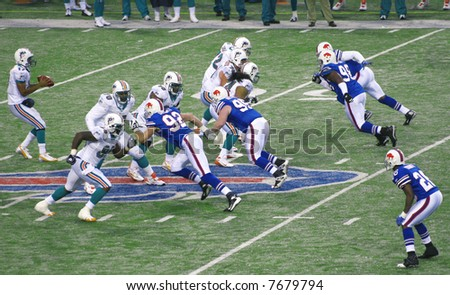 Miami Dolphins Defense protecting the quarterback against Buffalo Bills at Ralph Wilson Stadium, December 9, 2007 - stock photo