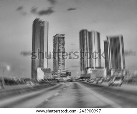 MIAMI - FEB 10: Blurred city streets on February 10, 2010 in Miami. More than 13 million people visit the city every year - stock photo