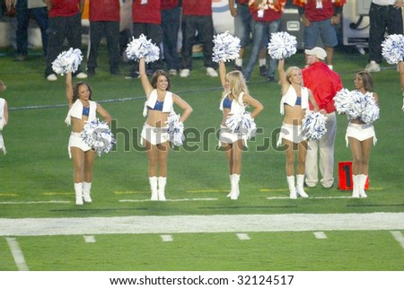 MIAMI - FEB 4: Indianapolis Colts cheerleaders cheer during Super Bowl XLI between the Indianapolis Colts and Chicago Bears at Dolphins Stadium on February 4, 2007 in Miami, Florida. - stock photo
