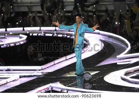 MIAMI - FEB 4: Prince gestures as he performs during half-time for Super Bowl XLI between the Chicago Bears and the Indianapolis Colts at Dolphin Stadium on February 4, 2007 in Miami. - stock photo