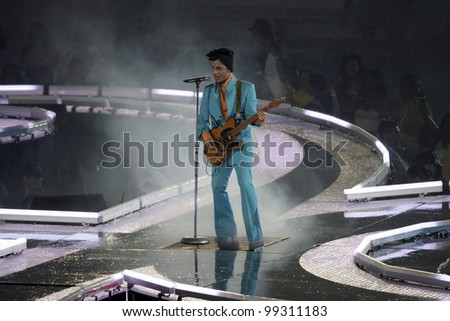 MIAMI - FEB 4: Prince performs during half-time for Super Bowl XLI between the Chicago Bears and the Indianapolis Colts at Dolphin Stadium on February 4, 2007 in Miami. - stock photo
