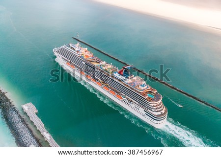 MIAMI - FEBRUARY 27, 2016: Aerial view of Cruise Ship departing from Miami Port. The city is a famous tropical destination for cruises. - stock photo