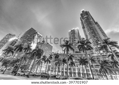 MIAMI - FEBRUARY 25, 2016: Black and white view of downtown city streets at night. Miami welcomes 15 million tourists every year. - stock photo