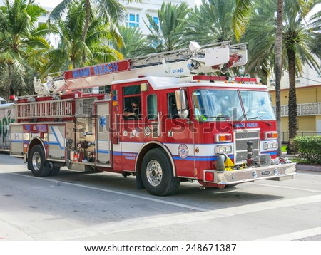 MIAMI,FL  - DECEMBER 2, 2013: Fireman truck on the streets.Firefighters patrol streets of Miami - stock photo