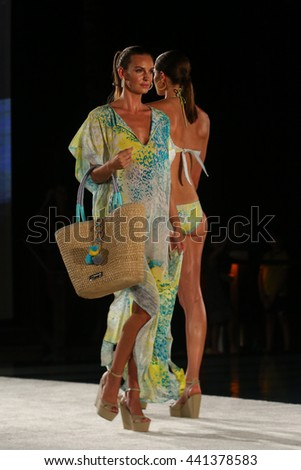 MIAMI, FL - JULY 18: A model walks runway in designer swim apparel during the Caffe Swimwear fashion show at W hotel for Miami Swim Week on July 18, 2015 - stock photo