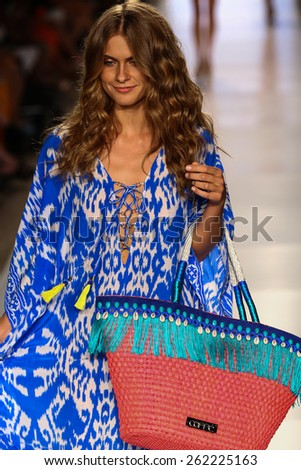 MIAMI, FL - JULY 20: A model walks the runway at the Caffe Swimwear during MBFW Swim 2015 at The Raleigh hotel on July 20, 2014 in Miami, FL. - stock photo