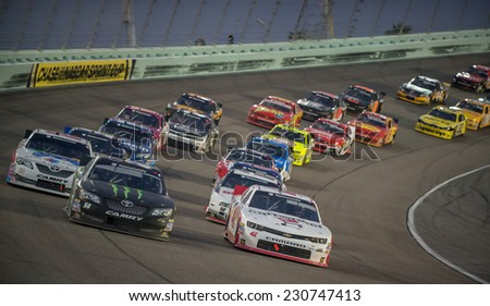 MIAMI, FL - Nov 15: Kyle Busch (54) and Kyle Larson (42) leading at the Nascar Nationwide Ford Ecoboost 300 race at Homestead-Miami, FL on November 15, 2014 - stock photo