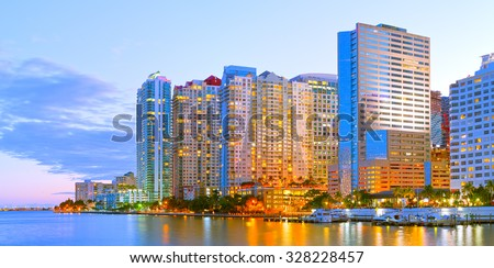 Miami Florida at sunset, colorful skyline of illuminated buildings - stock photo