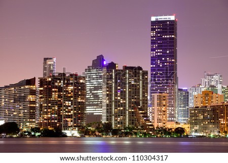 Miami Florida  buildings cityscape at night.  Illuminated business and luxury residential buildings and hotels. Long exposure panorama of World famous travel location. - stock photo